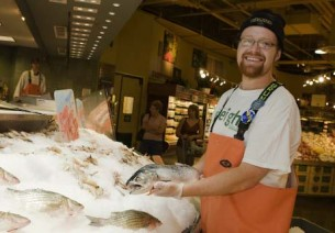 A fish monger selling sustainable seafood at Whole Foods